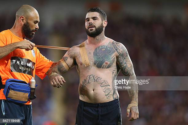 Adam Reynolds is treated for an injured during game two of the State Of Origin series between the Queensland Maroons and the New South Wales Blues at...