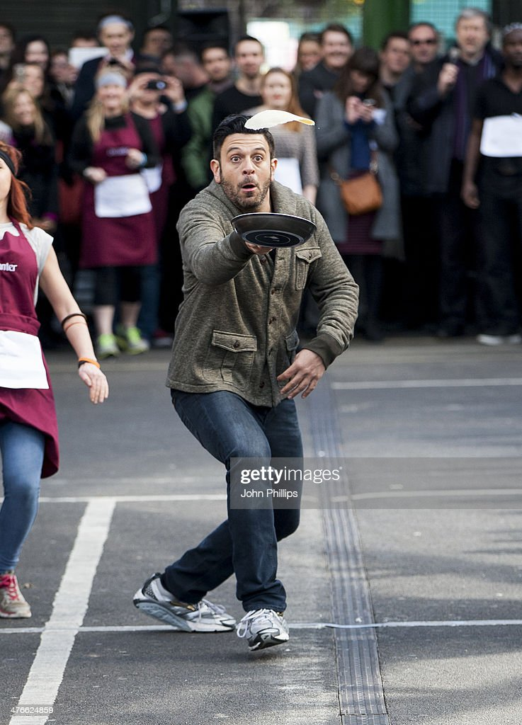 <a gi-track='captionPersonalityLinkClicked' href=/galleries/search?phrase=Adam+Richman&family=editorial&specificpeople=5635728 ng-click='$event.stopPropagation()'>Adam Richman</a> attends/takes part in the annual pancake day race hosted by Better Bankside on March 4, 2014 in London, England.