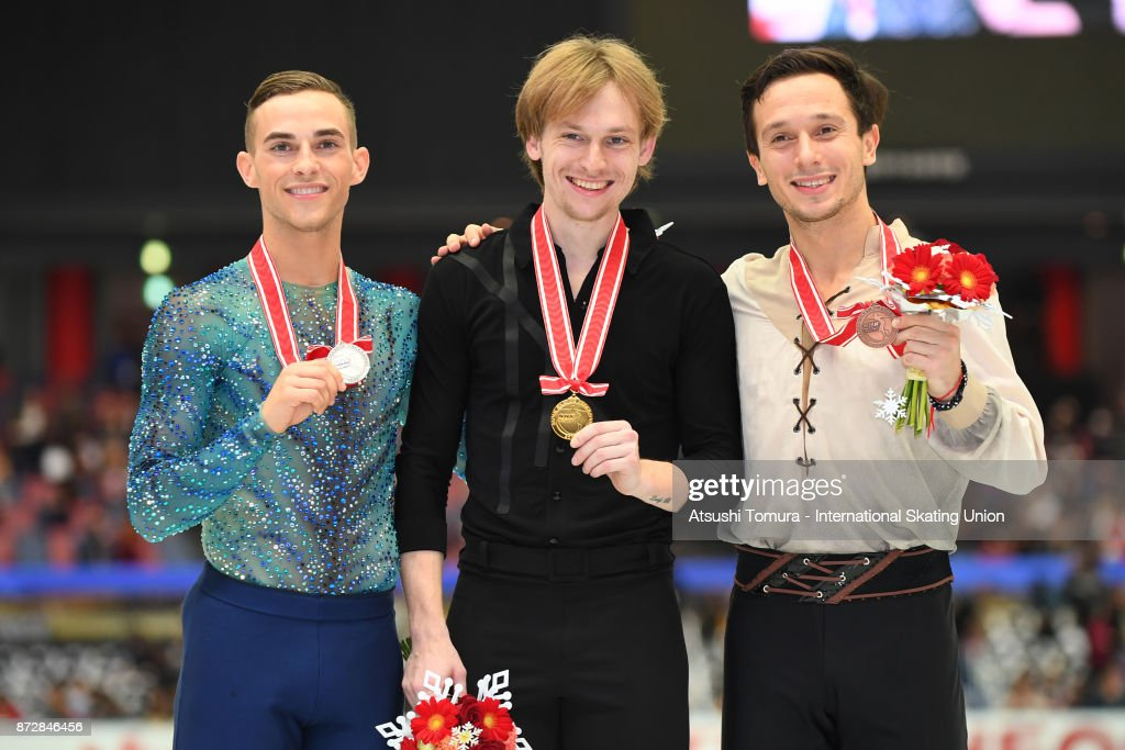 Adam Rippon of the USA (silver), Sergei Voronov of Russia (gold) and Alexei Bychenko of Israel (bronze) pose on the podium in the medal ceremony during the ISU Grand Prix of Figure Skating on November 11, 2017 in Osaka, Japan.