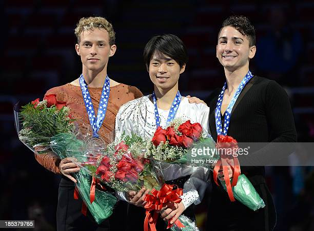 Adam Rippon wth silver Tatsuki Machida of Japan with gold and Max Aaron with bronze stand atop the podium after the men's free program at Skate...