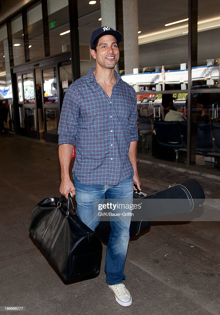 <a gi-track='captionPersonalityLinkClicked' href=/galleries/search?phrase=Adam+Rodriguez&family=editorial&specificpeople=212837 ng-click='$event.stopPropagation()'>Adam Rodriguez</a> is seen arriving at Los Angeles International Airport on November 02, 2013 in Los Angeles, California.