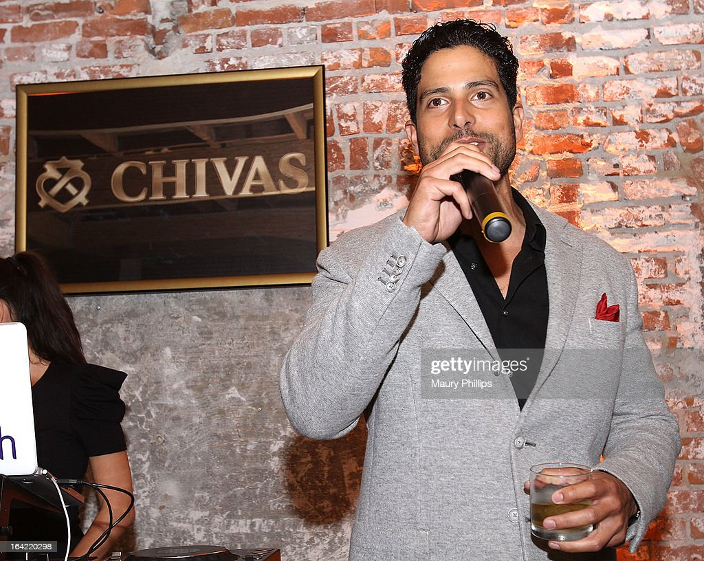 <a gi-track='captionPersonalityLinkClicked' href=/galleries/search?phrase=Adam+Rodriguez&family=editorial&specificpeople=212837 ng-click='$event.stopPropagation()'>Adam Rodriguez</a> toasts to chivarly and brotherhood at LA's Chivas Regal 1801 Club LA launch party on March 20, 2013 in Los Angeles, California.
