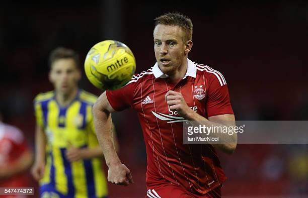 Adam Rooney of Aberdeen controls the ball during the UEFA Europa league second qualifying round first leg match between Aberdeen and Ventspils at...