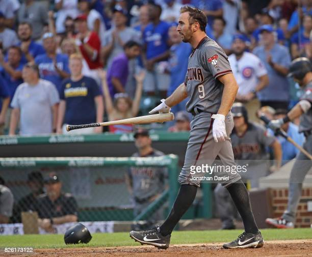Adam Rosales of the Arizona Diamondbacks drops his bat after striking out with men on base to end the 8th inning against the Chicago Cubs at Wrigley...