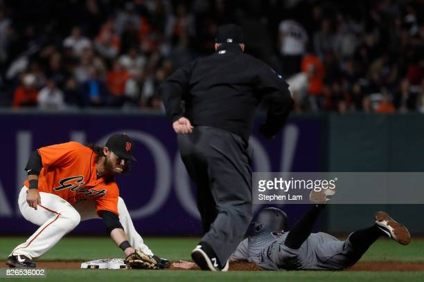 Adam Rosales of the Arizona Diamondbacks tries to steal at second base before being tagged out by Brandon Crawford of the San Francisco Giants during...
