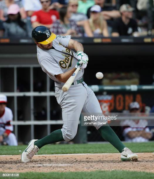 Adam Rosales of the Oakland Athletics hits a solo home run in the 9th inning against the Chicago White Sox at Guaranteed Rate Field on June 25 2017...