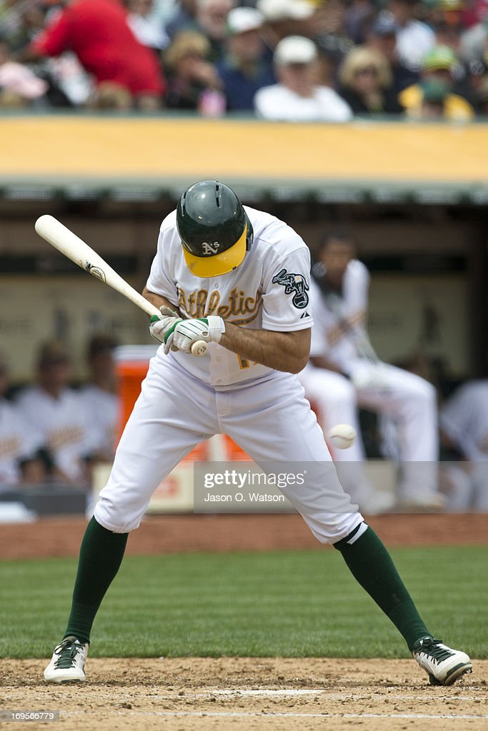 <a gi-track='captionPersonalityLinkClicked' href=/galleries/search?phrase=Adam+Rosales&family=editorial&specificpeople=4921731 ng-click='$event.stopPropagation()'>Adam Rosales</a> #17 of the Oakland Athletics is hit by a pitch thrown by Madison Bumgarner (not pictured) of the San Francisco Giants during the third inning of the interleague game at O.co Coliseum on May 27, 2013 in Oakland, California.