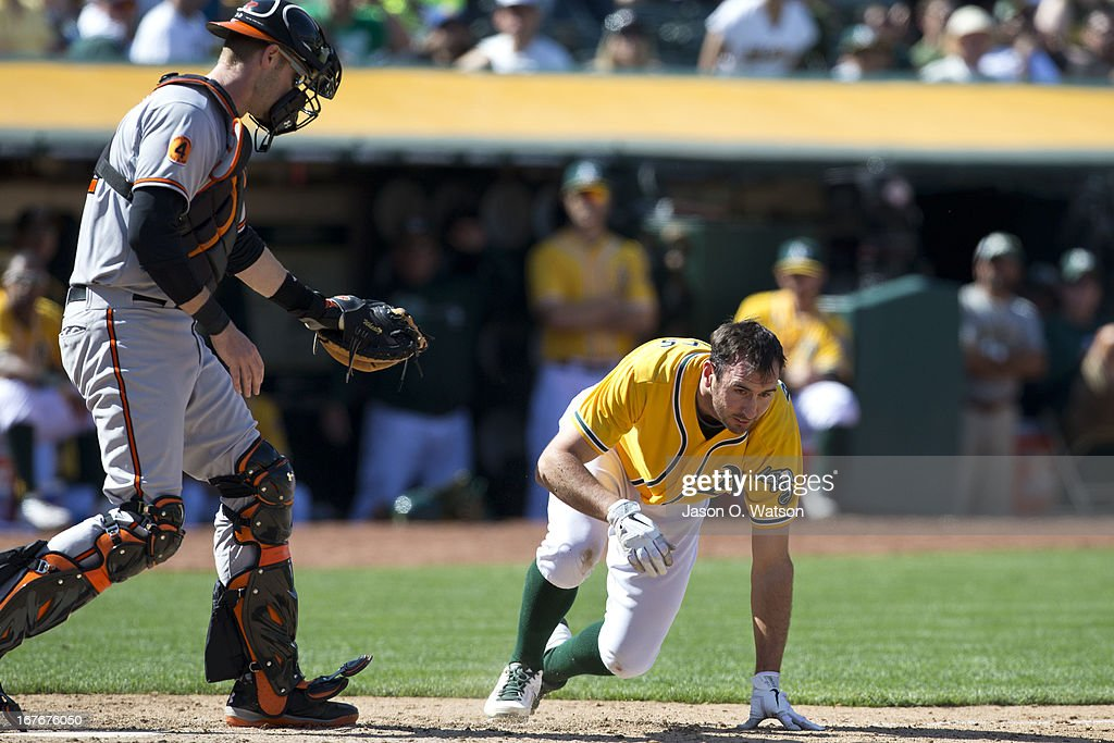 <a gi-track='captionPersonalityLinkClicked' href=/galleries/search?phrase=Adam+Rosales&family=editorial&specificpeople=4921731 ng-click='$event.stopPropagation()'>Adam Rosales</a> #17 of the Oakland Athletics is knocked to the ground in front of <a gi-track='captionPersonalityLinkClicked' href=/galleries/search?phrase=Matt+Wieters&family=editorial&specificpeople=4498276 ng-click='$event.stopPropagation()'>Matt Wieters</a> #32 of the Baltimore Orioles after getting hit in the head with a pitch during the ninth inning at O.co Coliseum on April 27, 2013 in Oakland, California. The Baltimore Orioles defeated the Oakland Athletics 7-3.