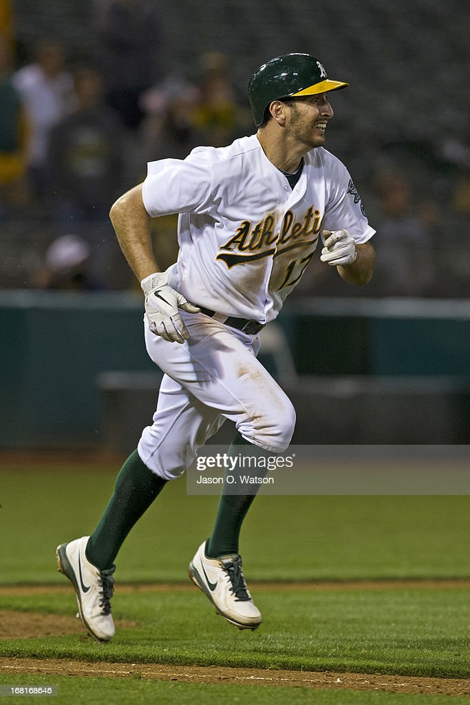 Adam Rosales #17 of the Oakland Athletics runs to first base after an at bat against the Los Angeles Angels of Anaheim during the eighteenth inning at O.co Coliseum on April 30, 2013 in Oakland, California. The Oakland Athletics defeated the Los Angeles Angels of Anaheim 10-8 in 19 innings.