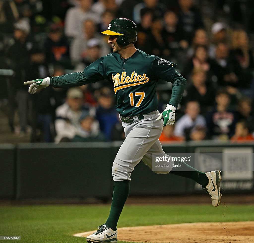 <a gi-track='captionPersonalityLinkClicked' href=/galleries/search?phrase=Adam+Rosales&family=editorial&specificpeople=4921731 ng-click='$event.stopPropagation()'>Adam Rosales</a> #17 of the Oakland Athletics smiles after crossing the plate after hitting the game-winning home run, a solo shot in the 10th inning, against the Chicago White Sox at U.S. Cellular Field on June 6, 2013 in Chicago, Illinois. The Athletics defeated the White Sox 5-4 in 10 innings.