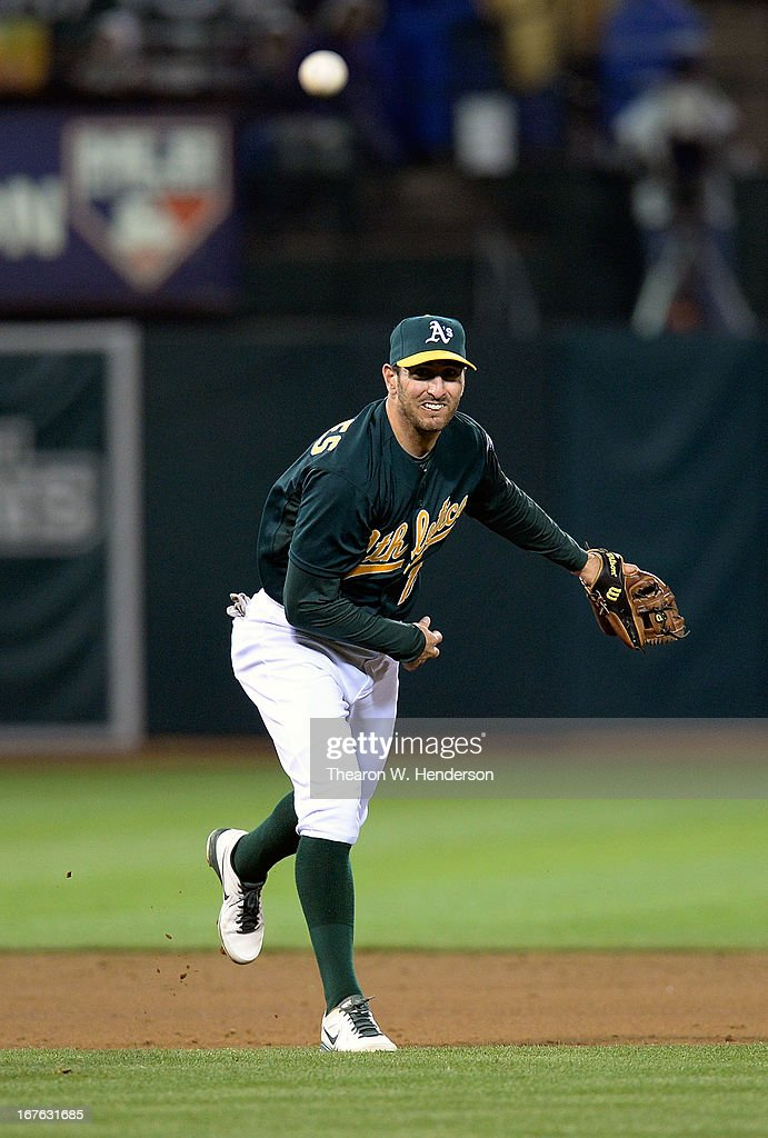 <a gi-track='captionPersonalityLinkClicked' href=/galleries/search?phrase=Adam+Rosales&family=editorial&specificpeople=4921731 ng-click='$event.stopPropagation()'>Adam Rosales</a> #17 of the Oakland Athletics throws out Adam Jones (not pictured) of the Batimore Orioles in the six inning at O.co Coliseum on April 26, 2013 in Oakland, California.