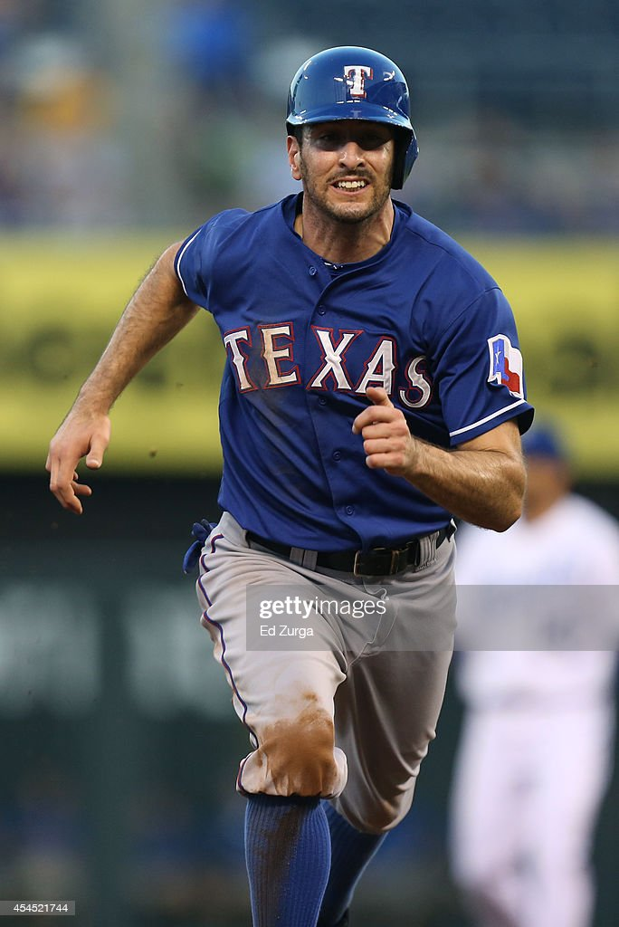 <a gi-track='captionPersonalityLinkClicked' href=/galleries/search?phrase=Adam+Rosales&family=editorial&specificpeople=4921731 ng-click='$event.stopPropagation()'>Adam Rosales</a> #9 of the Texas Rangers advances to third on a Rougned Odor #12 of the Texas Rangers fly out in the second inning during a game against the Kansas City Royals at Kauffman Stadium on September 2, 2014 in Kansas City, Missouri.