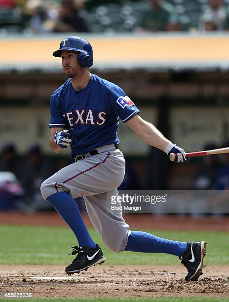 Adam Rosales of the Texas Rangers bats against the Oakland Athletics during the game at Oco Coliseum on Thursday September 18 2014 in Oakland...