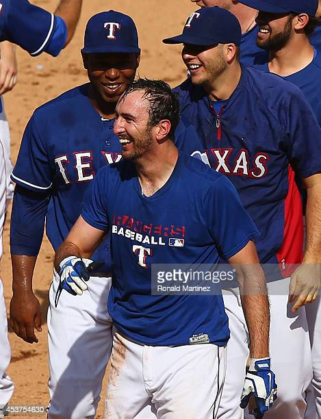 Adam Rosales of the Texas Rangers celebrates his RBI single in the ninth inning against the Los Angeles Angels at Globe Life Park in Arlington on...