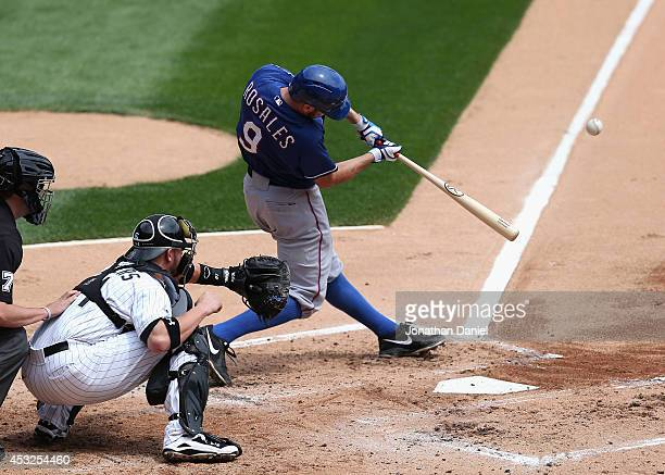 Adam Rosales of the Texas Rangers hits a tworun home run in the 2nd inning in front of Tyler Flowers of the Chicago White Sox at US Cellular Field on...