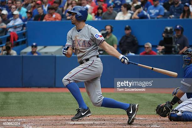 Adam Rosales of the Texas Rangers lines out in the sixth inning during MLB game action against the Toronto Blue Jays on July 20 2014 at Rogers Centre...