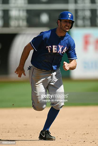 Adam Rosales of the Texas Rangers runs the bases against the Oakland Athletics in the top of the six inning at Oco Coliseum on September 18 2014 in...