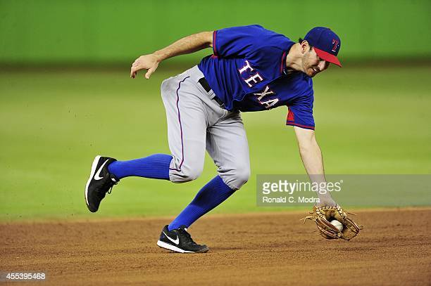 Adam Rosales of the Texas Rangers takes fielding practice before a MLB game against the Miami Marlins at Marlins Stadium on August 19 2014 in Miami...