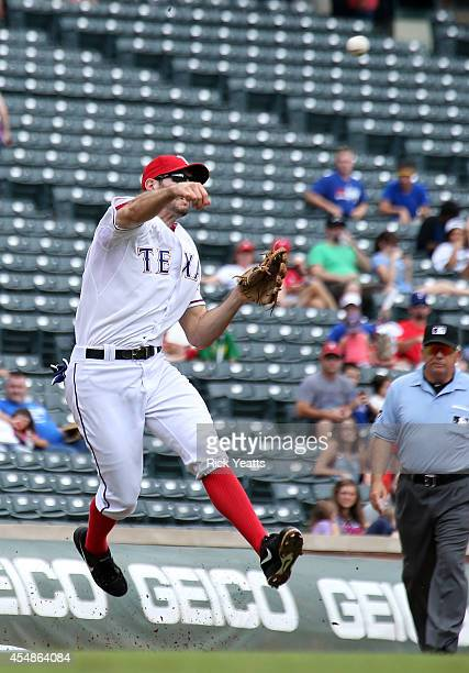 Adam Rosales of the Texas Rangers throws out Chris Denorfia of the Seattle Mariners in the first inning at Globe Life Park in Arlington on September...