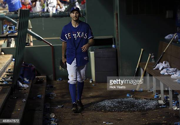 Adam Rosales of the Texas Rangers walks through the dugout after the game an the win against the Tampa Bay Rays at Globe Life Park in Arlington on...
