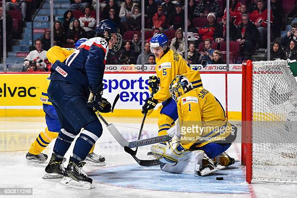 Adam Ruzicka of Team Slovakia gets the puck past goaltender Felix Sandstrom of Team Sweden during the 2017 IIHF World Junior Championship...