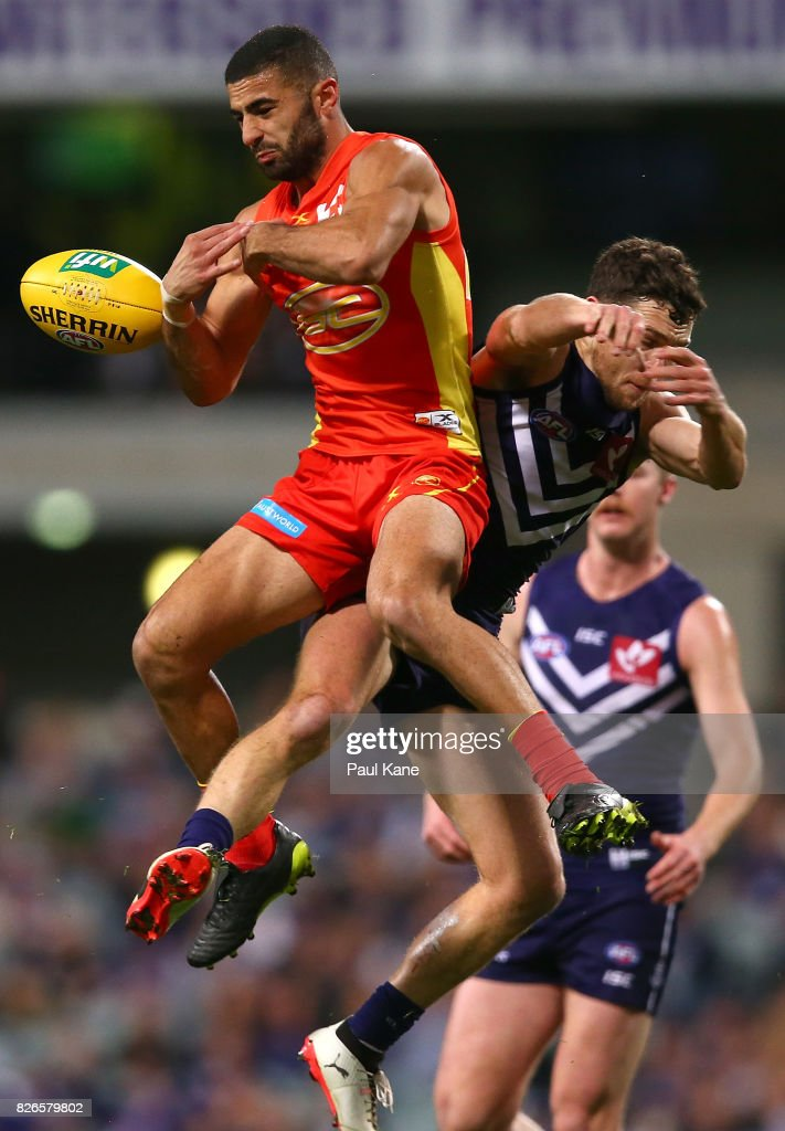 Adam Saad of the Suns and Hayden Ballantyne of the Dockers contest for a mark during the round 20 AFL match between the Fremantle Dockers and the Gold Coast Suns at Domain Stadium on August 5, 2017 in Perth, Australia.