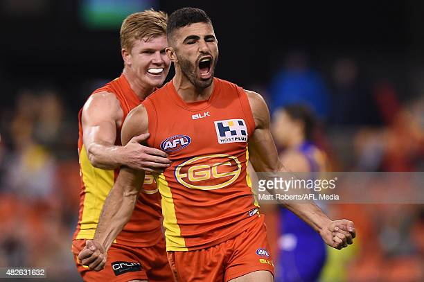 Adam Saad of the Suns celebrates during the round 18 AFL match between the Gold Coast Suns and the West Coast Eagles at Metricon Stadium on August 1...