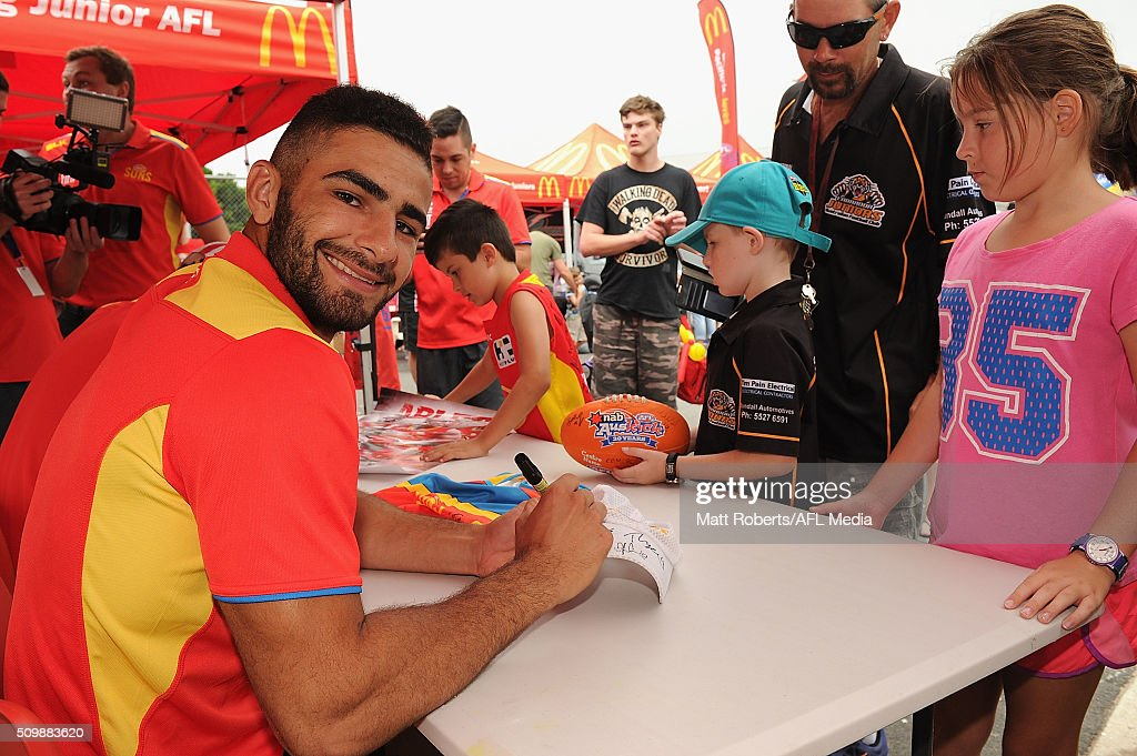 Adam Saad signs autographs for fans during the Gold Coast Suns AFL open day at Metricon Stadium on February 13, 2016 on the Gold Coast, Australia.