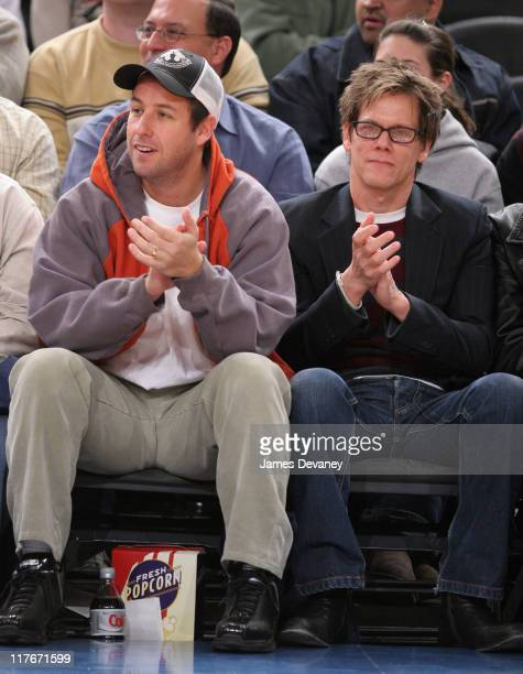 Adam Sandler and Kevin Bacon during Celebrities Attend Chicago Bulls vs New York Knicks Game March 3 2006 at Madison Square Garden in New York City...