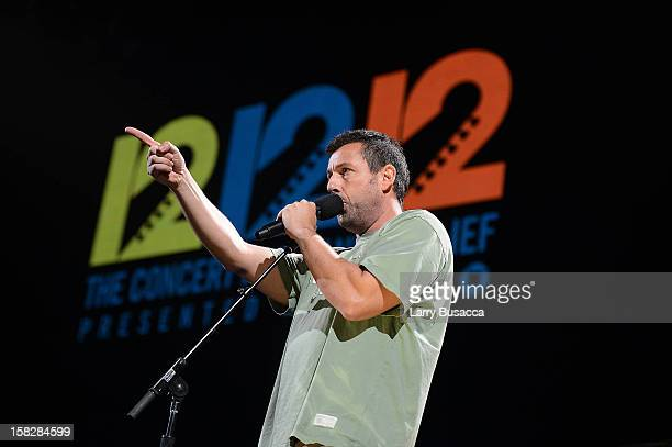 Adam Sandler performs at '121212' a concert benefiting The Robin Hood Relief Fund to aid the victims of Hurricane Sandy presented by Clear Channel...