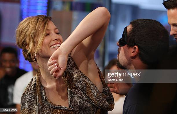 Adam Sandler sniffs Jessica Biel's armpit during MTV's Total Request Live at the MTV Times Square Studios on July 16 2007 in New York City