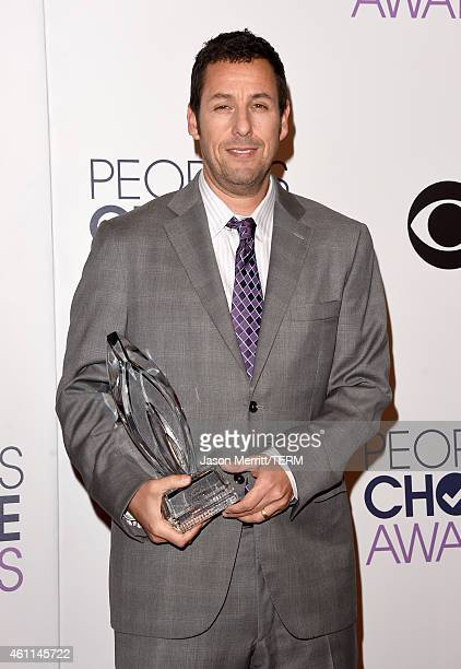 Adam Sandler winner of Favorite Comedic Movie Actor poses in the press room at The 41st Annual People's Choice Awards at Nokia Theatre LA Live on...
