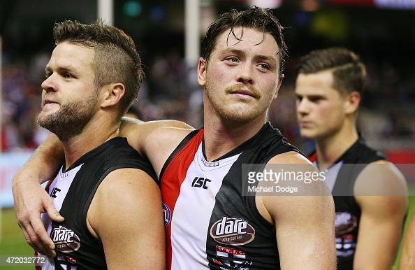 Adam Schneider of the Saints who missed an easy goal to put the team ahead in the dying stages is hugged by Jack Steven of the Saints after defeat...