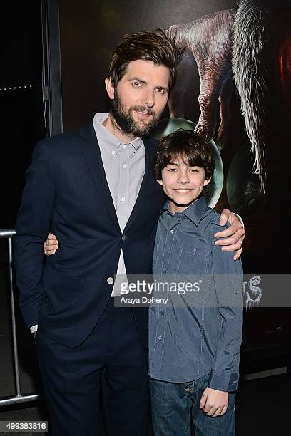 Adam Scott and Emjay Anthony attend the Industry Screening of Universal Pictures' 'Krampus' at ArcLight Cinemas on November 30 2015 in Hollywood...