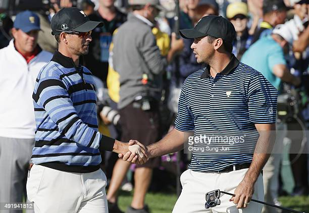 Adam Scott and Jason Day of Australia and the International Team shake hands on the 18th green after the Mickelson/Johnson and Day/Scott match was...