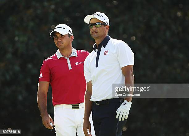 Adam Scott and Jason Day of Australia wait together on the 14th tee during the first round of the TOUR Championship By CocaCola at East Lake Golf...