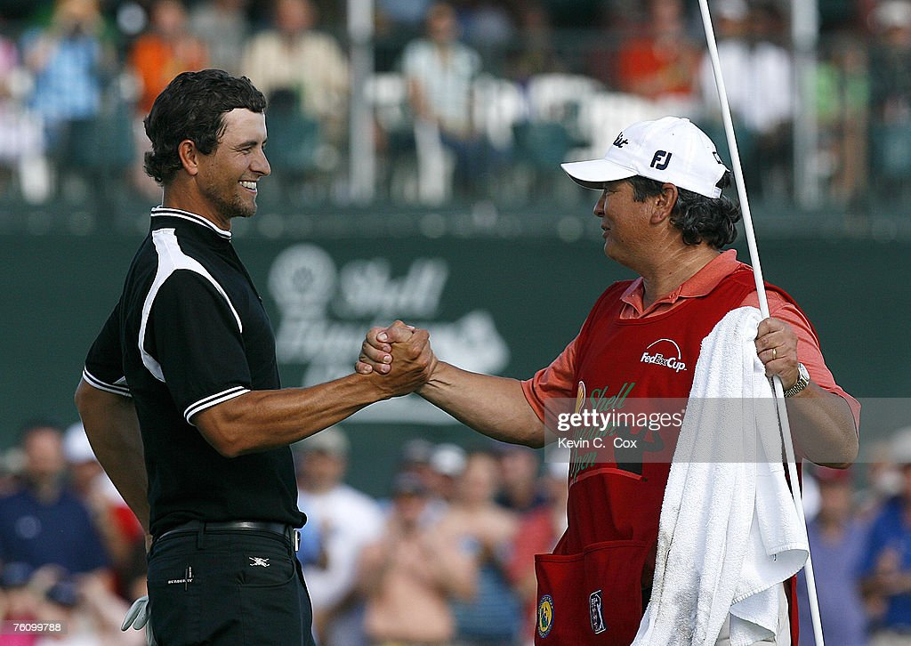 Adam Scott celebrates with his caddie Tony Navarro after winning the 2007 Shell Houston Open Sunday April 1 on the Tournament Course at the Redstone...