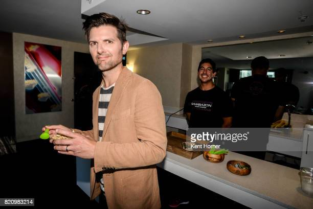 Adam Scott enjoying a Sambazon Acai Bowl in the EW Studio at San Diego Comic Con on July 20 2017 in San Diego California