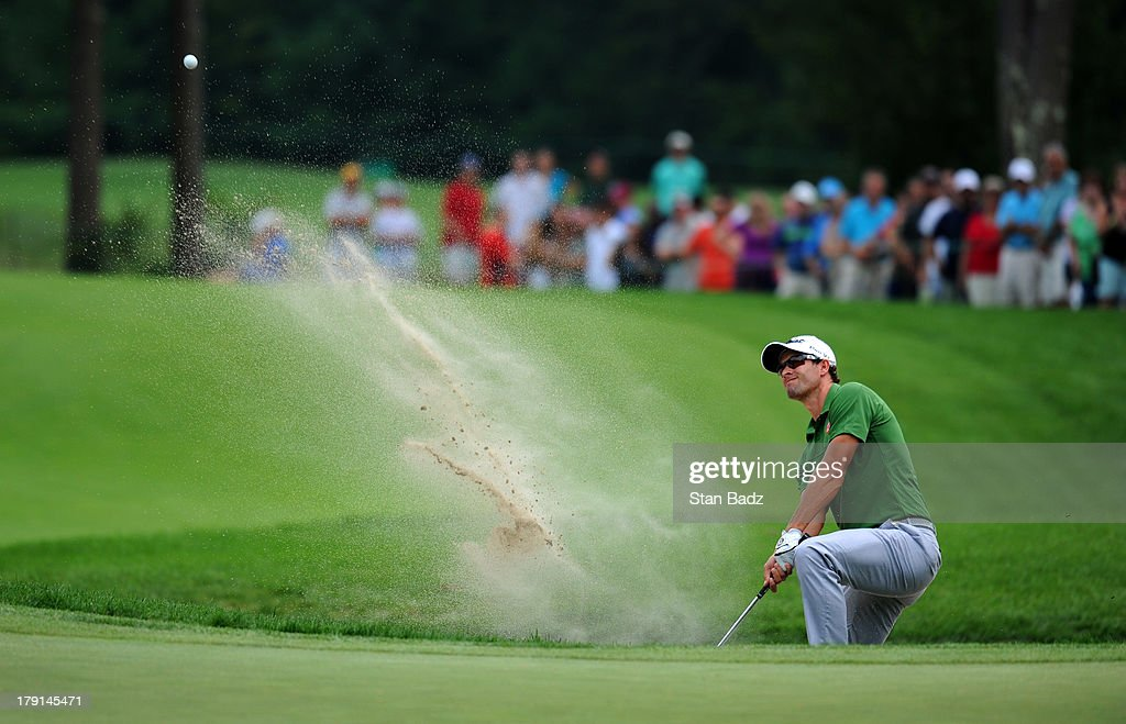 Adam Scott hits from a bunker on the sixth hole during the second round of the Deutsche Bank Championship at TPC Boston on August 31, 2013 in Norton, Massachusetts.