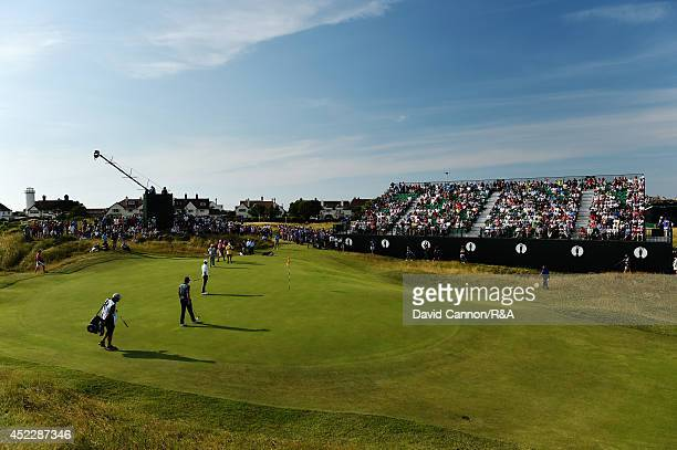 Adam Scott of AustralAdam Scott of Australia Justin Rose of England Jason Dufner of the United States walk onto the 14th green during the first round...