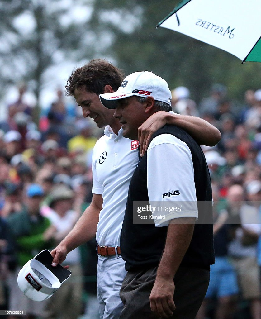Adam Scott of Australia and <a gi-track='captionPersonalityLinkClicked' href=/galleries/search?phrase=Angel+Cabrera&family=editorial&specificpeople=204515 ng-click='$event.stopPropagation()'>Angel Cabrera</a> of Argentina after the second play off hole which saw Scott win the Green Jacket during the final round of the 2013 Masters at the Augusta National Golf Club on April 14, 2013 in Augusta, Georgia.