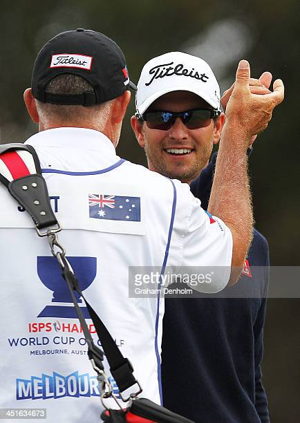 Adam Scott of Australia and his caddie Steve Williams celebrate afer making eagle on the par four 1st hole during day four of the World Cup of Golf...