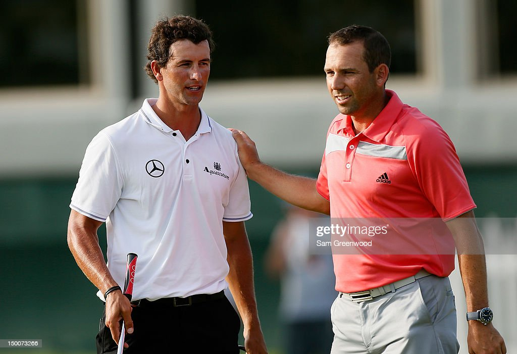 Adam Scott of Australia (L) and Sergio Garcia of Spain speak after completing Round One of the 94th PGA Championship at the Ocean Course on August 9, 2012 in Kiawah Island, South Carolina.