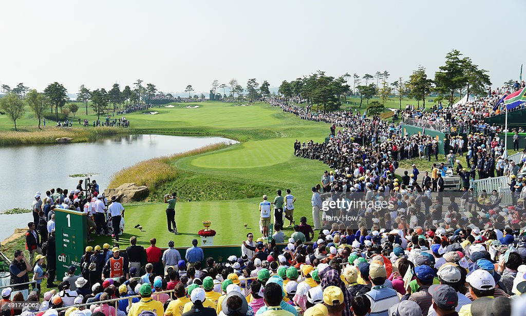 Adam Scott of Australia and the International Team hits the first shot of the Thursday foursomes matches on the first hole at The Presidents Cup at Jack Nicklaus Golf Club Korea on October 8, 2015 in Songdo IBD, Incheon City, South Korea