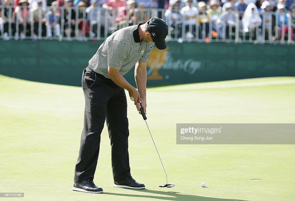 Adam Scott of Australia and the International Team putts on the 13th green during the Thursday foursomes matches at The Presidents Cup at Jack Nicklaus Golf Club Korea on October 8, 2015 in Songdo IBD, Incheon City, South Korea
