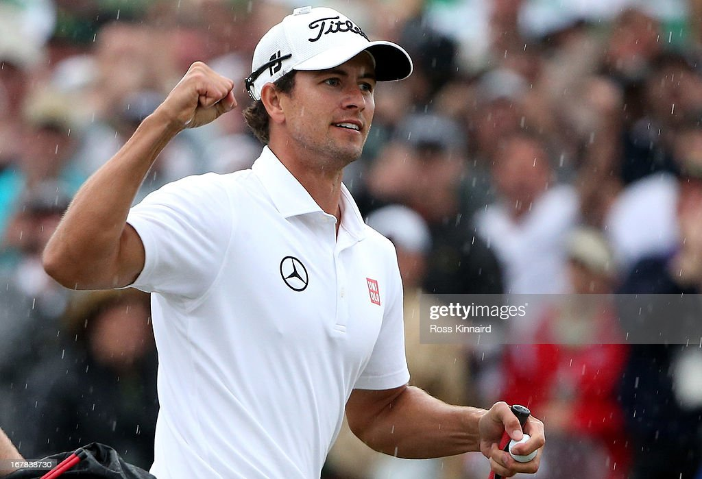 Adam Scott of Australia celebrates after his birdie on the 18th green which got him into a play off during the final round of the 2013 Masters at the Augusta National Golf Club on April 14, 2013 in Augusta, Georgia.