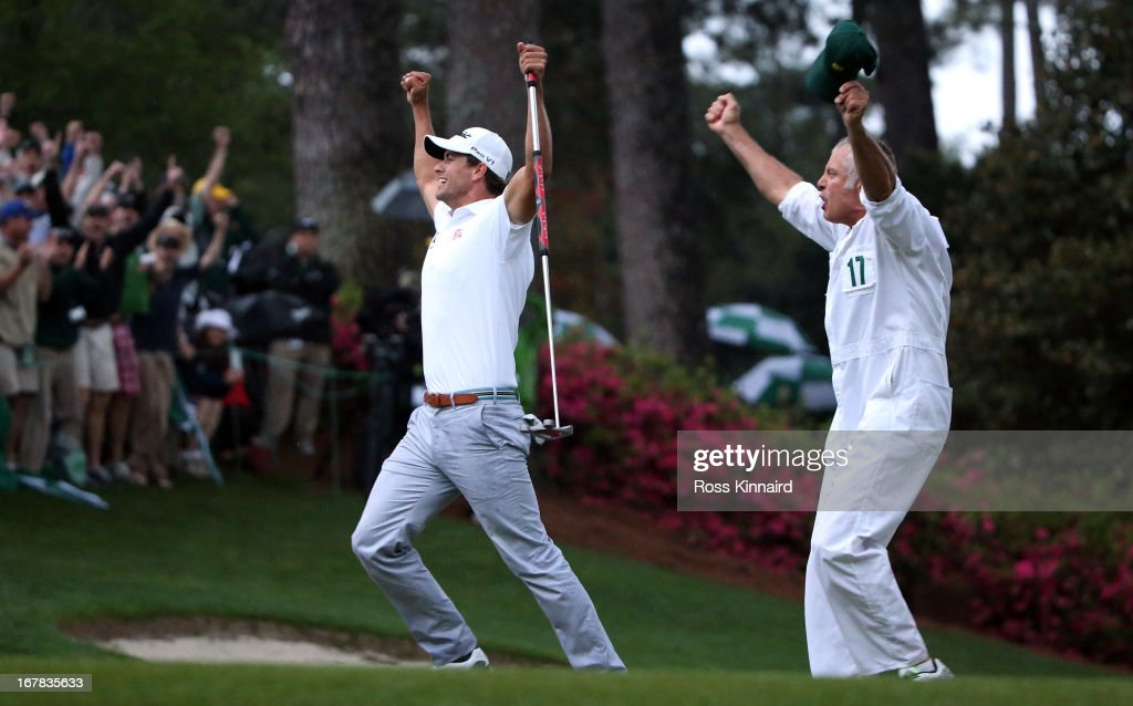 <a gi-track='captionPersonalityLinkClicked' href=/galleries/search?phrase=Adam+Scott&family=editorial&specificpeople=202039 ng-click='$event.stopPropagation()'>Adam Scott</a> of Australia celebrates after his birdie putt on the second play off hole which saw him win the Green Jacket during the final round of the 2013 Masters at the Augusta National Golf Club on April 14, 2013 in Augusta, Georgia.