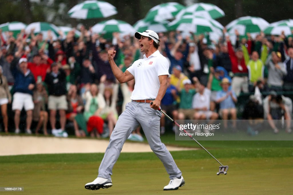Adam Scott of Australia celebrates after making a birdie on the 18th hole during the final round of the 2013 Masters Tournament at Augusta National...