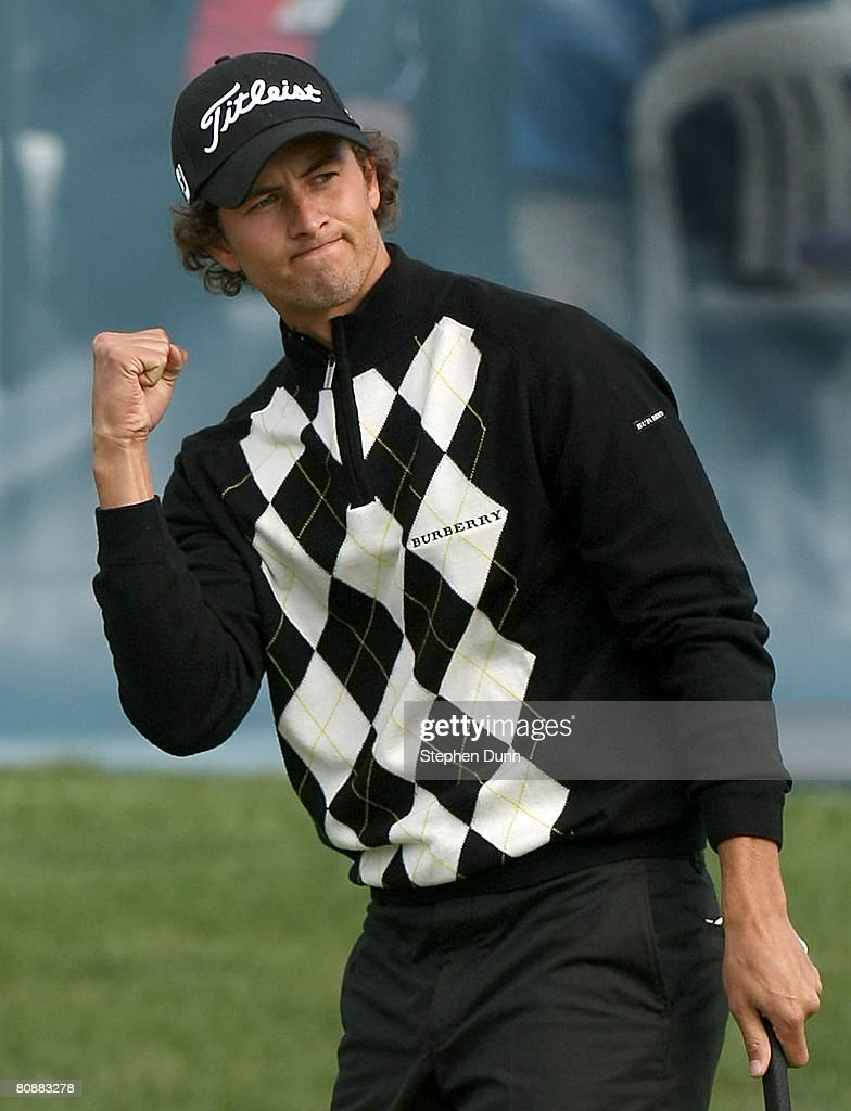 Adam Scott of Australia celebrates after sinking a birdie putt on the 18th hole to force a playoff during the final round of the EDS Byron Nelson...