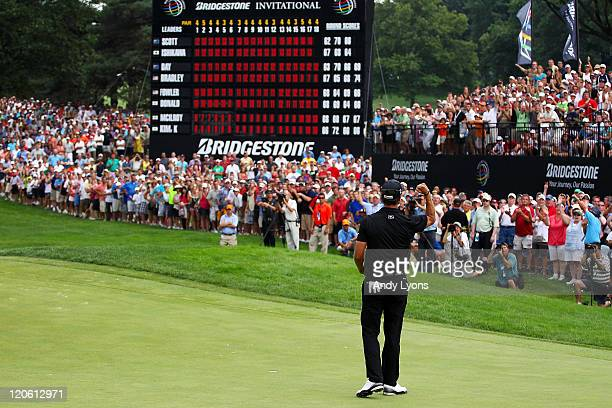 Adam Scott of Australia celebrates on the 18th green after winning the final round of the World Golf ChampionshipsBridgestone Invitational on the...